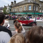 Presumably the Grand Marshall - with local dignitaries atop the bus