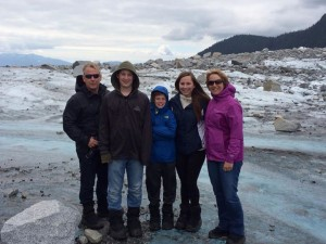 The Shepard family standing on the glacier after helicopter landing. (Where did it go?)